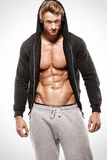 Strong Athletic muscle Man showing abdominal muscles in jacket Stock Photo