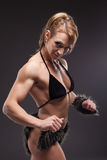 Strong athletic woman body builder posing Royalty Free Stock Images