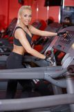 Strong athletic woman working out in a gym royalty free stock photo