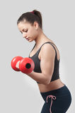 Strong attractive girl with dumbbell Royalty Free Stock Photography