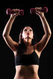 Strong beautiful fitness girl weight lifting Royalty Free Stock Image