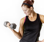 Strong Beautiful fitness woman lifting dumbbell weights Stock Photos