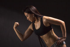 Strong and beautiful. Studio shot of a gorgeous sporty woman loo Royalty Free Stock Images