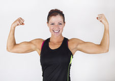 Strong Beautiful Woman flexing her muscles Royalty Free Stock Photography