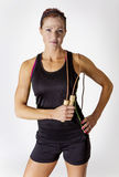 Strong Beautiful Woman with a jump rope Royalty Free Stock Images