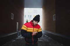 Strong big dangerous man in gateway. Winter time. Street mugger. Social concept of submission.  Royalty Free Stock Photography