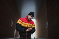 Strong big dangerous man in gateway. Winter time. Street mugger. Social concept of submission.  stock photos