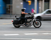Strong biker woman Stock Image