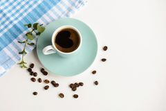 Strong black coffee in a light blue cup on a white table. Strong black coffee in a light blue cup on a white table Royalty Free Stock Photo