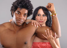 Strong Black Man showing biceps to woman Stock Image