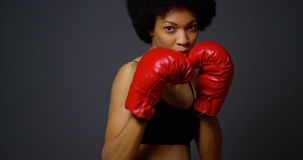 Strong Black Woman Athlete with boxing gloves Royalty Free Stock Image