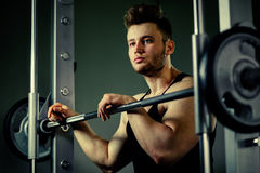 Strong bodybuilder athlete with heavy  weights in gym Stock Photography