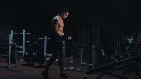 Strong bodybuilder doing crossfit exercises stock video