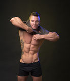 Strong bodybuilder dress shirt Royalty Free Stock Images
