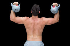 Strong bodybuilder lifting up kettlebells Royalty Free Stock Photos
