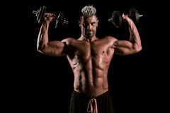 Strong bodybuilder man with perfect abs, shoulders,biceps, trice Royalty Free Stock Image