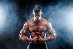 Strong bodybuilder man with perfect abs, shoulders,biceps, triceps, chest. stock images