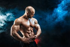 Strong bodybuilder man with perfect abs, shoulders,biceps, triceps, chest. Strong bald bodybuilder with six pack. Bodybuilder man with perfect abs, shoulders royalty free stock images