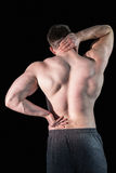 Strong bodybuilder with painful back and neck Stock Images