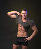 Strong bodybuilder shows news Stock Images