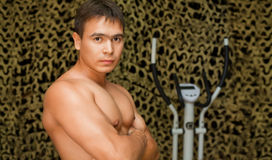 Strong bodybuilder training muscles in gym Royalty Free Stock Photo