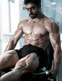 Strong bodybuilder training quads Stock Image