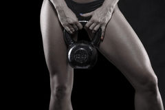 Strong bodybuilder woman holding kettlebell isolated Stock Image