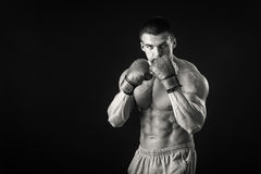 Strong boxer on a black background Royalty Free Stock Image