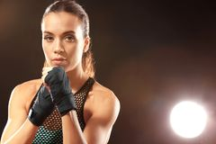 Strong boxer woman. On black background Stock Photo