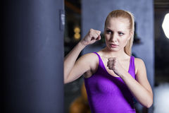 Strong boxing woman exercise in a gym Stock Photography