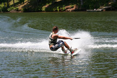 Strong Boy. Teenage boy showing his skill on his wakeboard Royalty Free Stock Image