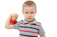 Strong boy with apple isolated on white background Royalty Free Stock Photo
