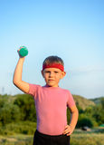 Strong Boy Raising Dumbbell with One Hand on Waist Royalty Free Stock Image