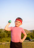 Strong Boy Raising Dumbbell with One Hand on Waist Royalty Free Stock Photo