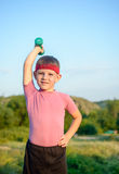 Strong Boy Raising Dumbbell with One Hand on Waist Stock Image