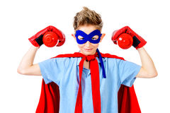 Strong boy. A boy teenager in a costume of superhero. Isolated over white background stock photos