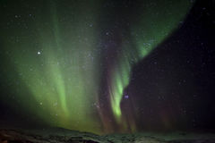 Strong bright green aurora northern lights over mountain Royalty Free Stock Photos