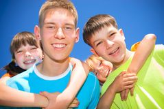 Strong brothers. Four young siblings hold together Royalty Free Stock Images