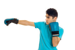Strong brunette sports man oracticing boxing in blue gloves isolated on white background Stock Photo