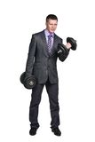 Strong businessman. Strong business man with dumbbell isolated on a white background royalty free stock photography