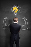Strong businessman has an idea Royalty Free Stock Image