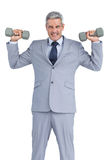 Strong businessman lifting dumbbells Royalty Free Stock Photo