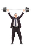 Strong businessman lifting a heavy weight Royalty Free Stock Photo