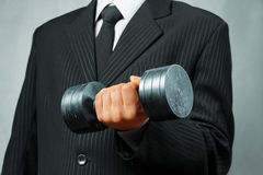 Strong businessman with metal dumbbell Royalty Free Stock Photos