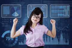 Strong businesswoman with business chart Stock Image