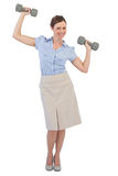 Strong businesswoman lifting dumbbells looking at camera Royalty Free Stock Photos
