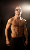 Strong caucasian male on black background Royalty Free Stock Photos