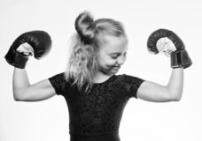 Strong child boxing. Sport and health concept. Boxing sport for female. Be strong. Girl child with blue gloves posing on royalty free stock images