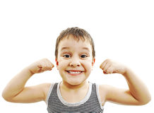 Strong Child Showing His Muscles and healthy teeth. Child. Funny Little Boy.Sport Handsome Boy. Strong. bodybuilder. showing his hand biceps muscles and healthy Stock Image