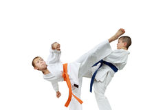 Strong children athletes are beating blows kicks Stock Images